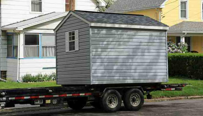 Using a low-boy to move a shed can help make the job not so tuff. Shed preparation includes removing all contents to be sure it is empty, especially of any hazardous materials.